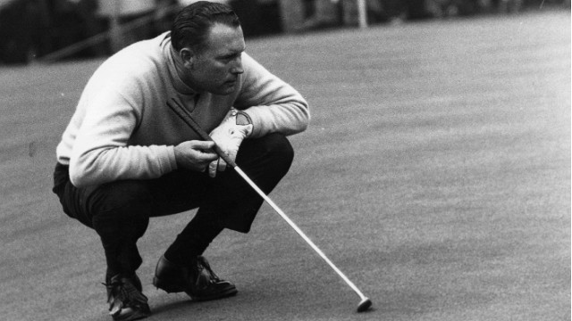 Golfer Billy Casper, who won the 1966 US Open, lining up a put. (Photo by Evening Standard/Getty Images)