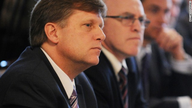 US ambassador to Russia, Michael McFaul (L), takes part in a round table discussion on NGO cooperation between the two countries in Moscow, on April 4, 2013.