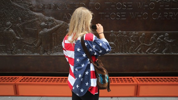 A woman takes photos of the 9/11 Memorial in New York on September 10.