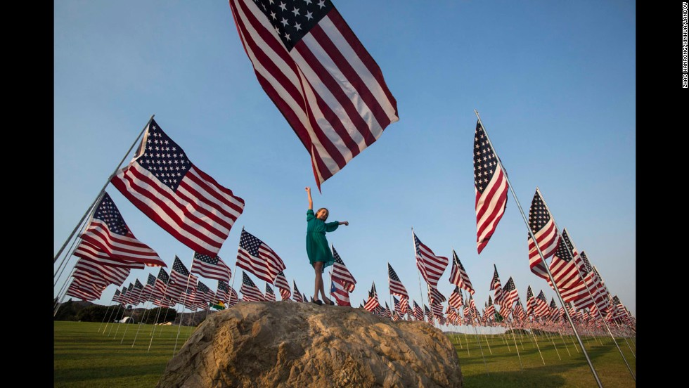 A girl poses among American flags that Pepperdine University students and staff erected in Malibu, California, on September 10.