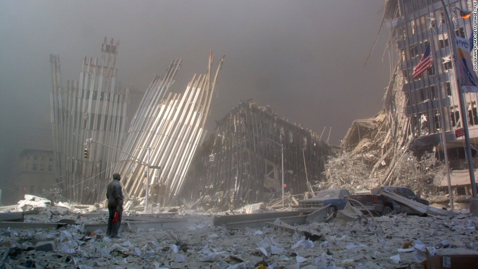 A man stands in the rubble after the collapse of the first World Trade Center tower.