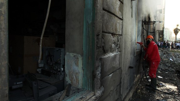 A firefighter douses the inside of the building on September 11.