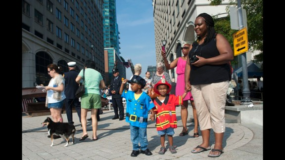 Tonya Festa and her sons attend a memorial ceremony in Jersey City.