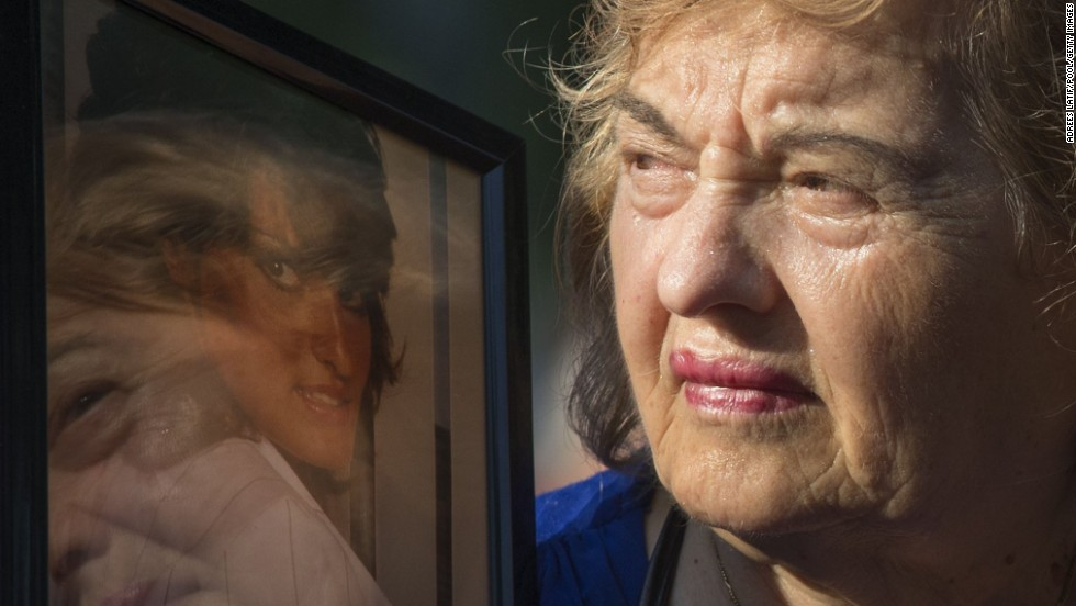 Ester DiNardo, mother of Marisa DiNardo, clutches a photograph of her daughter at the 9/11 Memorial ceremonies in New York.