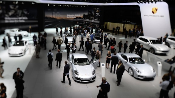 Visitors look at Porsche cars at the IAA international automobile show on September 11, 2013 in Frankfurt, Germany.