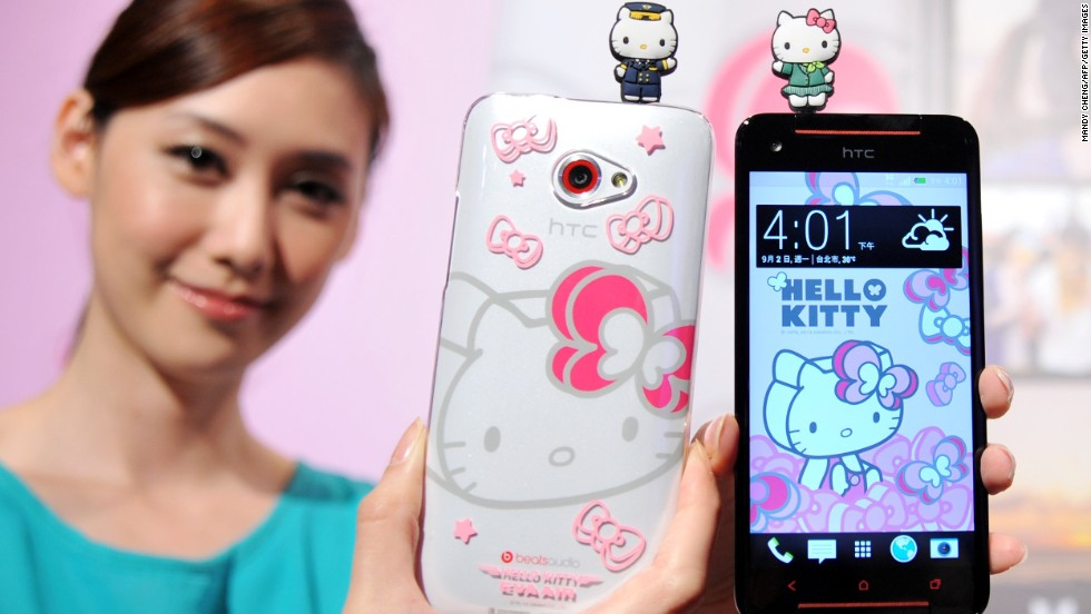 "A model displays Taiwan electronics giant HTC's new smartphone ""HTC Butterfly S Hello Kitty"" with accessories during a press conference in Taipei on September 2, 2013."