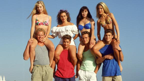The cast back in the day, including Jennie Garth, upper left, and the late Luke Perry, second from right among the guys.