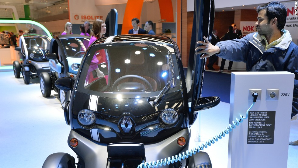A visitor closes the door of the Renault Twizy electric drive at the IAA international automobile show on September 11, 2013 in Frankfurt, Germany.