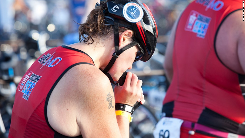 The triathletes learned during training how to transition from one leg of the race to the next. Here Miller prepares for the cycling portion of the race.