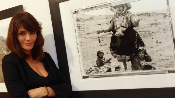 After a career in front of the camera, Danish supermodel Helena Christensen now works behind the lens, pictured here at a 2009 London exhibition of her work. Chirstensen