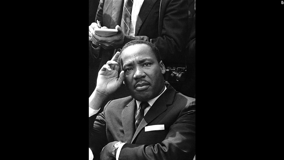 "Martin Luther King Jr. holds a press conference in Birmingham the day after the attack. He said the U.S. Army ""ought to come to Birmingham and take over this city and run it."""