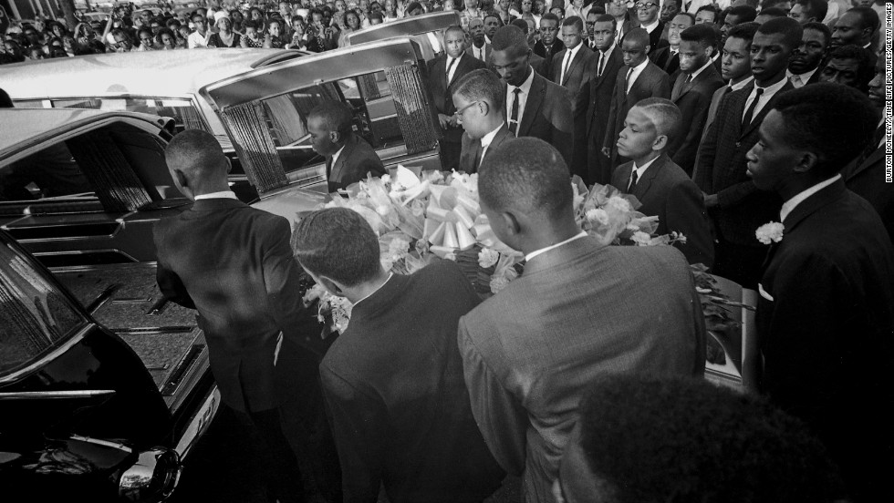 A coffin is loaded into a hearse at a funeral for the girls. An estimated 8,000 people attended the service.