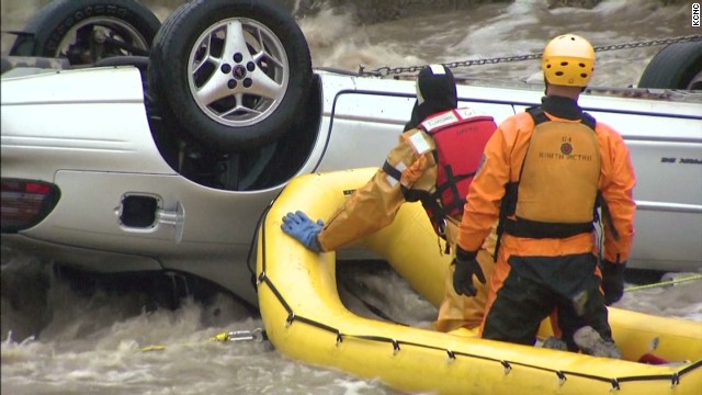 Man trapped in flooding, overturned car
