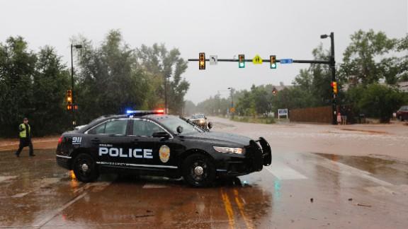A police officer blocks off a road in Boulder on September 12.