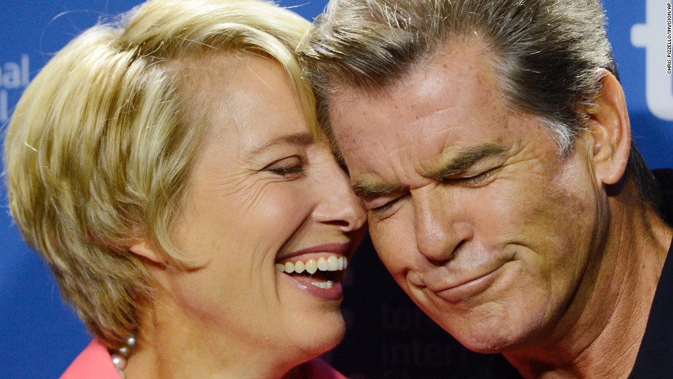 Emma Thompson and Pierce Brosnan share a moment before the press conference September 12.
