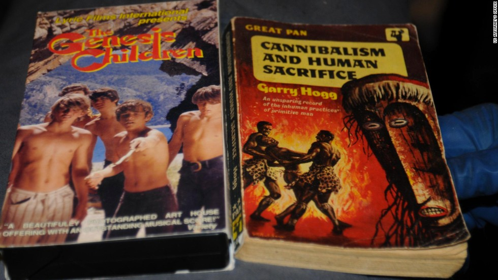 """The Genesis Children"" VHS and ""Cannibalism and Human Sacrifice"" book are more of the disturbing items police found."