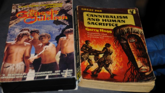 """""""The Genesis Children"""" VHS and """"Cannibalism and Human Sacrifice"""" book are more of the disturbing items police found."""
