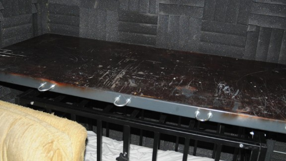 This steel cage and steel topped table is in the dungeon.