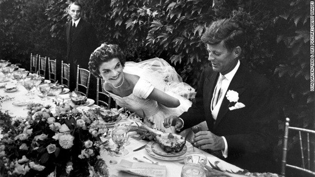 John and Jacqueline Kennedy enjoy lunch during their wedding reception in Newport, Rhode Island, on September 12, 1953.