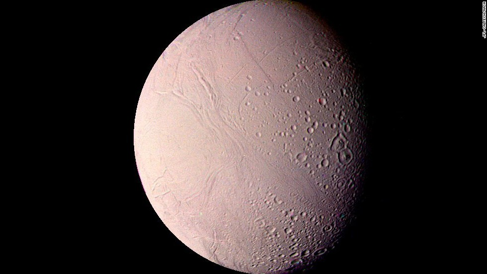 This image of Saturn's moon Enceladus shows impact craters up to 22 miles in diameter, as well as smooth uncratered areas.