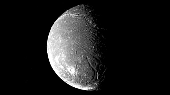 Ariel, another of Uranus' satellite's, shows a densely pitted surface that is also crisscrossed with numerous valleys and fault scarps.