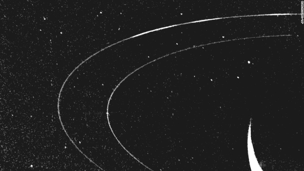This image of Neptune's outermost ring shows how material clumps into three arcs.