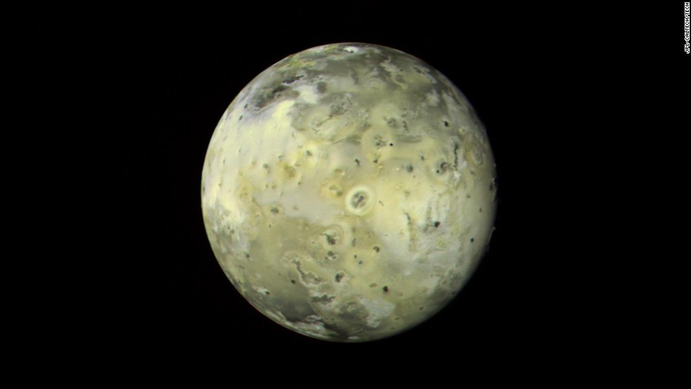 This mosaic image of Jupiter's moon Io shows a variety of features that appear linked to the intense volcanic activity. The circular, doughnut-shaped feature in the center has been identified as a known erupting volcano