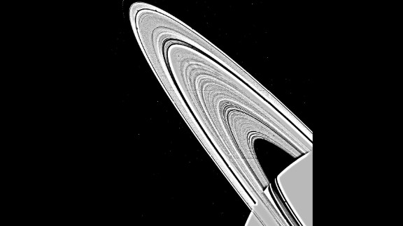 A mosaic image  of Saturn's rings, taken by NASA's Voyager 1 on November 6, 1980, shows approximately 95 individual concentric features in the rings. The ring structure was once thought to be produced by the gravitational interaction between Saturn's satellites and the orbit of ring particles, but has now been found to be too complex for this explanation alone.