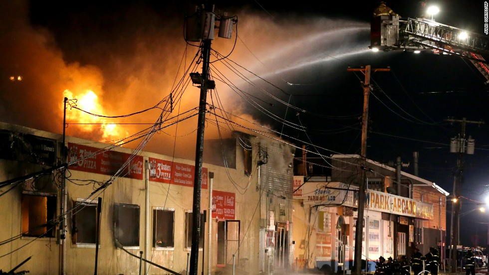 Firefighters battle a blaze in a building on the boardwalk in Seaside Park, New Jersey, on September 12.