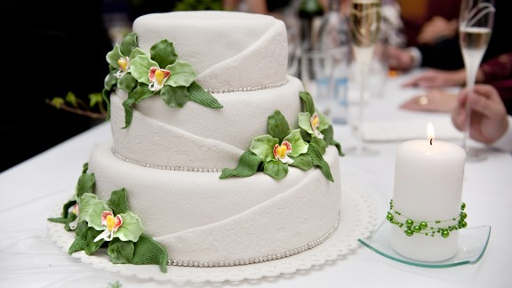 """Wedding cake makes a great photo op, but many guests just take a bite or two, if any. Consider a small """"show cake"""" and a less-expensive dessert bar."""