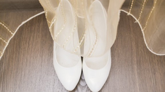 Fancy shoes also might not be worth the splurge. They're often hidden under the dress, and brides slip them off the first second they can.
