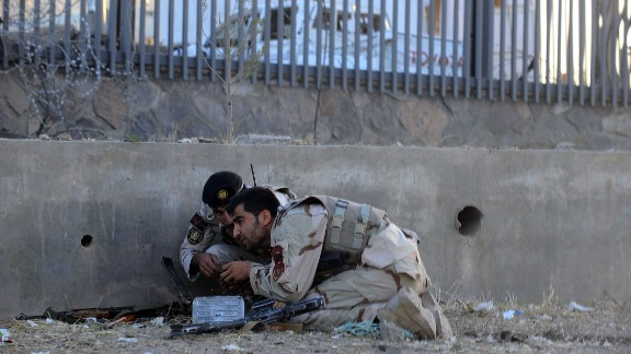 Afghanistan security forces take their position during an attack on the U.S. consulate on September 13. Gunmen staged an attack on the consulate killing two local police officers and a local security guard, police and hospital officials said. Twenty others were injured.