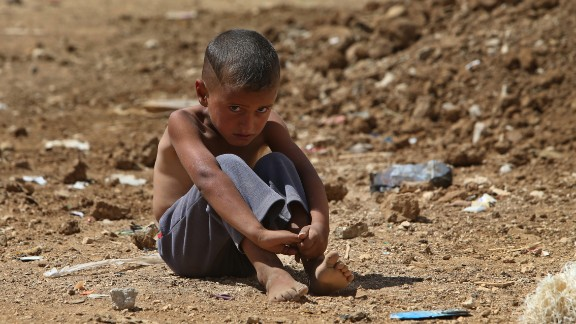 A refugee boy sits on the ground at a temporary refugee camp in the eastern Lebanese town of al-Faour in September 2013.