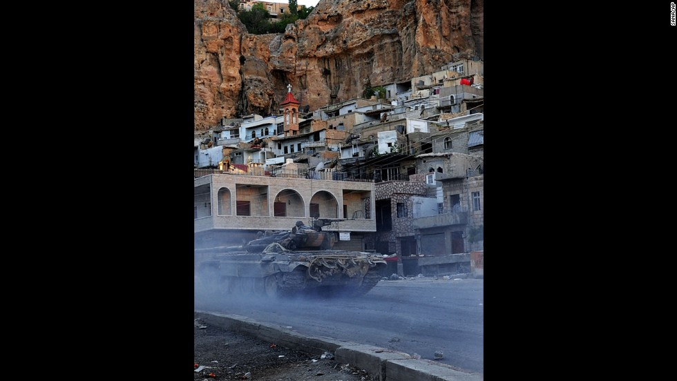 A Syrian government tank is seen during clashes with Free Syrian Army fighters in Maaloula, Syria, on September 11.