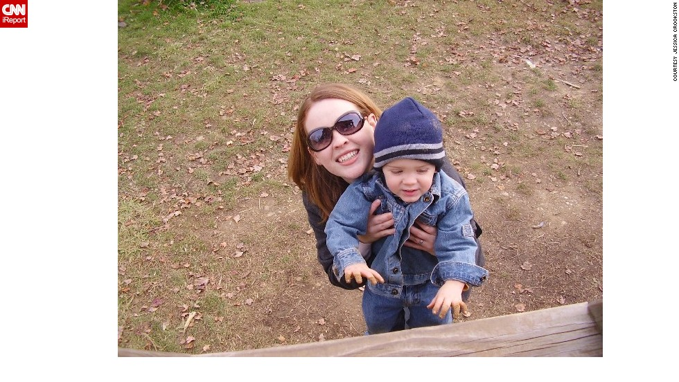 "Crookston and Samuel smile for the camera on their annual trip to the pumpkin patch in September 2006. ""With only one child to pay for, we definitely are able to do more of these types of excursions than if there were multiple children,"" Crookston said."