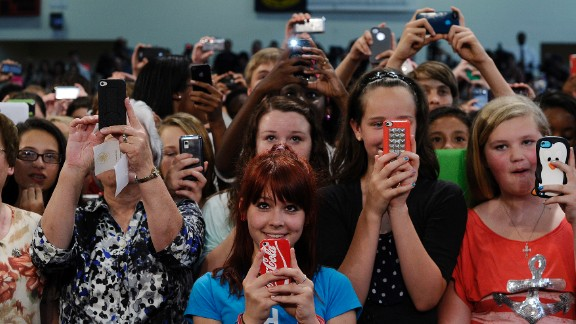 Teachers and students listen to US President Barack Obama at Mooresville Middle School in Mooresville, North Carolina, on June 6, 2013. Obama arrived in North Carolina as part of his Middle Class Jobs & Opportunity Tour.