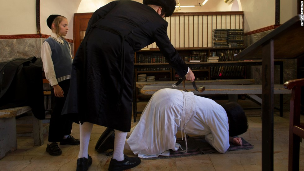 An ultra-Orthodox Jewish man whips another ultra-Orthodox Jew with a leather strap as a symbolic punishment for his sins during the traditional Malkot ceremony, ahead of Yom Kippur, in Jerusalem.