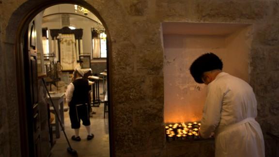 An ultra-Orthodox Jewish man lights a candle ahead of Yom Kippur in Jerusalem.