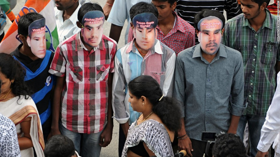 Members of the Karnataka State Youth Congress, wearing masks of the four convicted rapists, attend a demonstration after the sentencing.