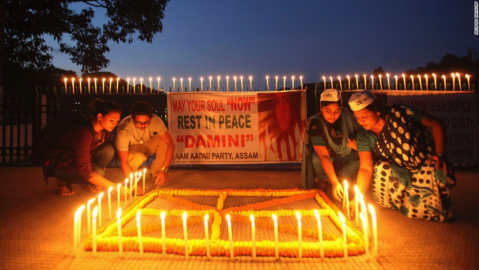 People light candles in Gauhati, India, to mark the verdict.
