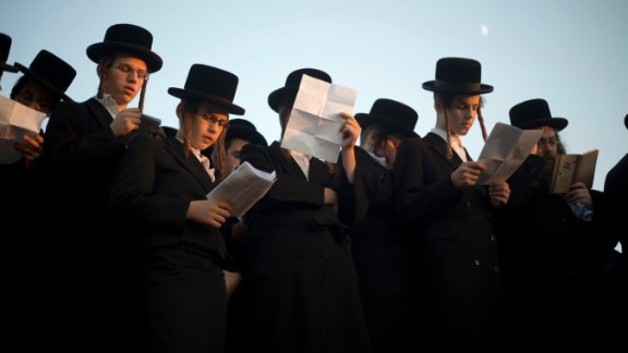 Ultra-Orthodox Jews pray on the Hayarkon river banks as they participate in a Tashlich ceremony in the Israeli town of Ramat Gan near Tel Aviv.