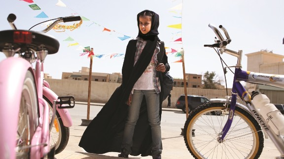 """A still from the film """"Wadjda"""", about an 11-year-old girl who dreams of owning a green bicycle."""