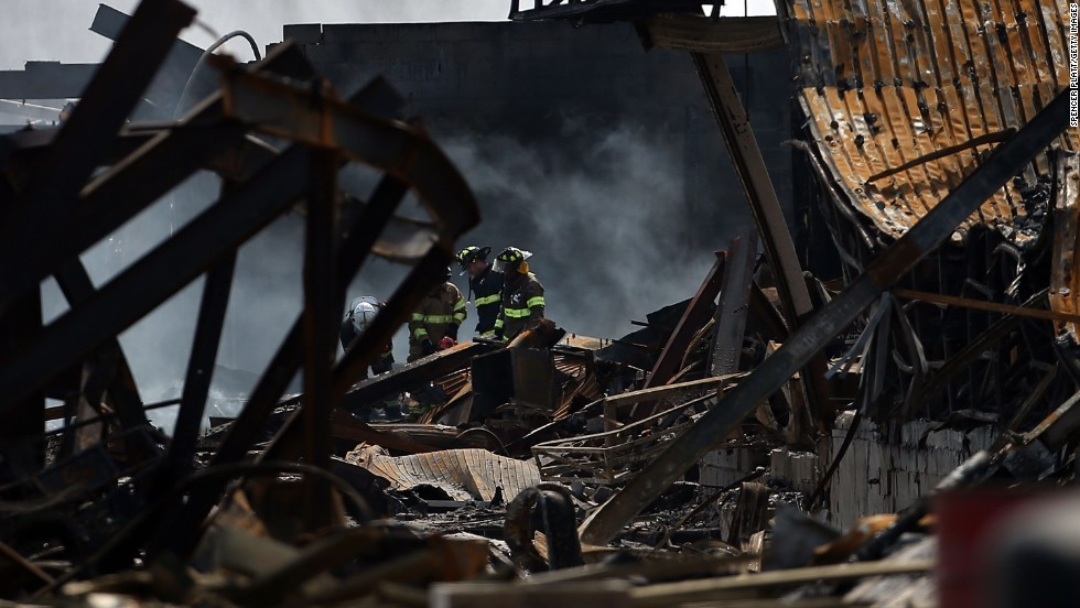 Firefighters walk through the destroyed businesses on the boardwalk on September 13.