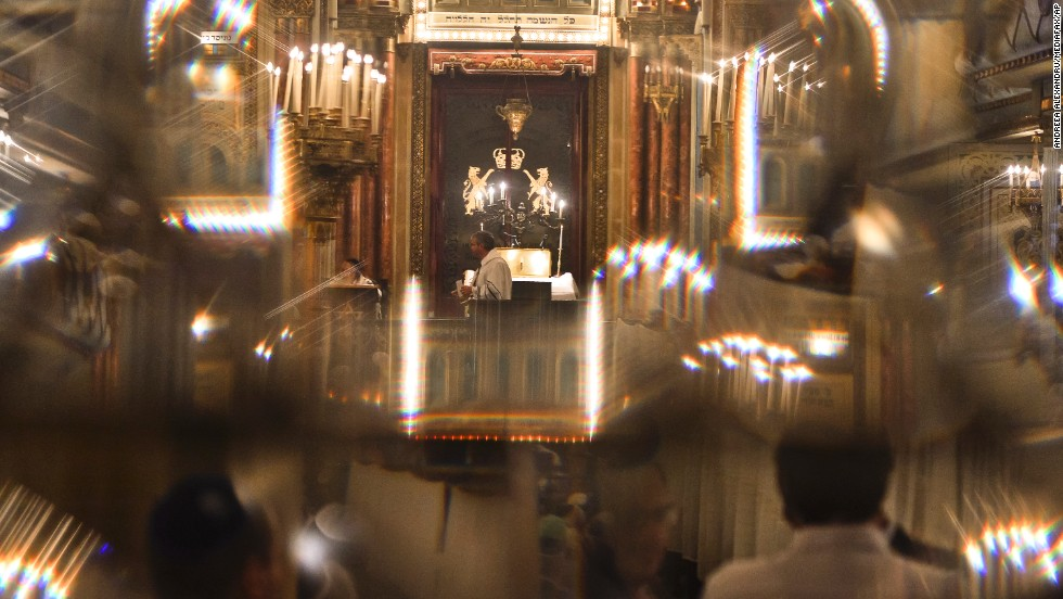 Romanian Jews, seen through a glass door, attend a religious service ahead of Yom Kippur at the Great Synagogue in Bucharest, Romania.