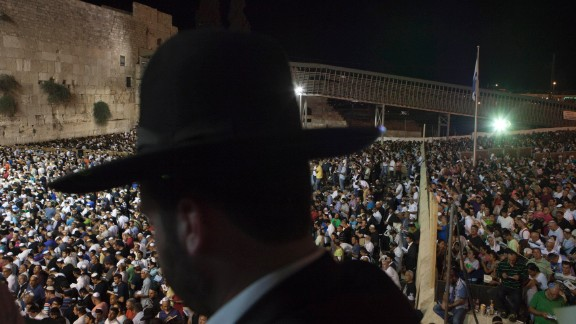 Men and women participate in a Selichot prayer ahead of the Jewish holiday of Yom Kippur at the Western Wall in Jerusalem. Selichot is Hebrew for forgiveness.
