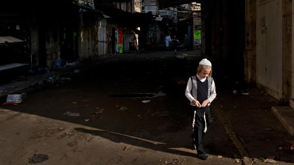 A child walks in Jerusalem's Mea Shearim neighborhood.