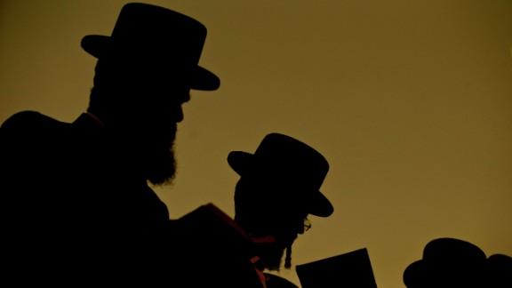 Ultra-Orthodox Jewish men pray along the Ayarkon River in the city of Ramat Gan near Tel Aviv.