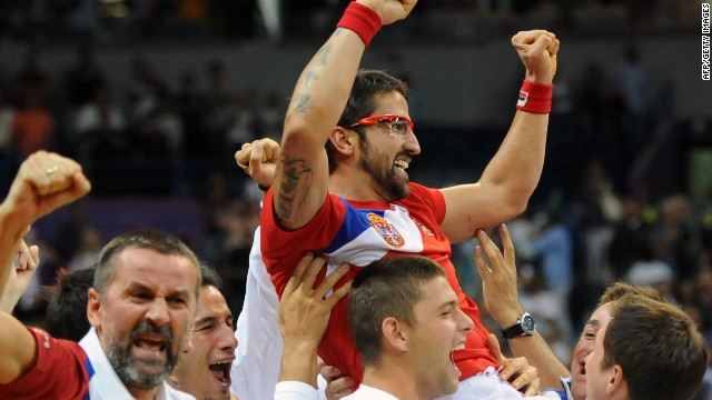 The Serbian team celebrate with Janko Tipsarevic after he lifted them to a 3-2 win over Canada.