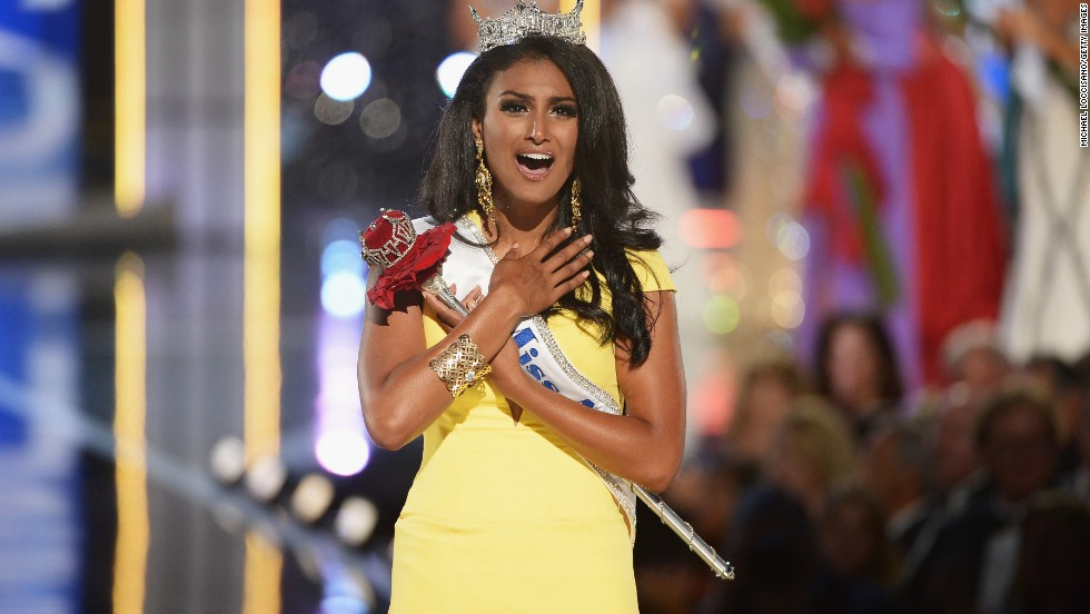 "When <a href=""http://www.cnn.com/2013/09/16/showbiz/miss-america-racist-reactions/index.html"">24-year-old Nina Davuluri became the first Indian-American Miss America</a>, many women cheered the barrier-breaking victory. But within minutes, joy turned to negativity after a flurry of racist comments surfaced on social media over her win. The <a href=""http://www.cnn.com/2013/10/30/living/identity-miss-america-nina-davuluri/index.html"">University of Michigan graduate, who is making diversity her platform, told CNN</a>, ""For every negative comment or post or tweet that I received, I received hundreds and thousands of words of encouragement and support."""