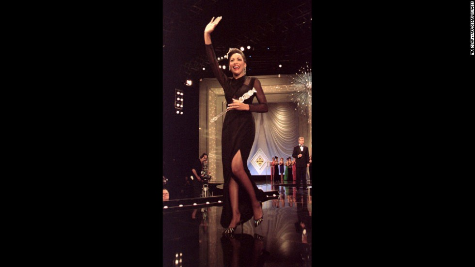 Miss America 1994, Kimberly Clarice Aiken, waves to the crowd as she walks down the runway. Aiken said she planned to spend her year-long reign aiding homeless people.